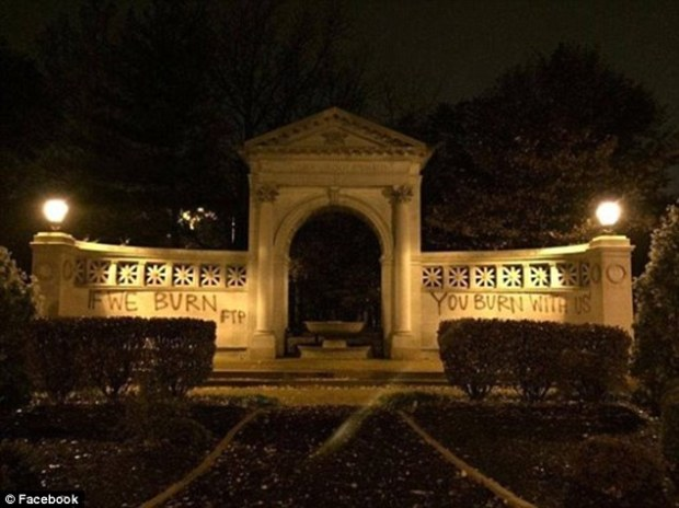 23775C1C00000578-2847503-Vandalized_The_arch_in_St_Louis_was_scrawled_with_a_logo_from_Th-6_1416848778653