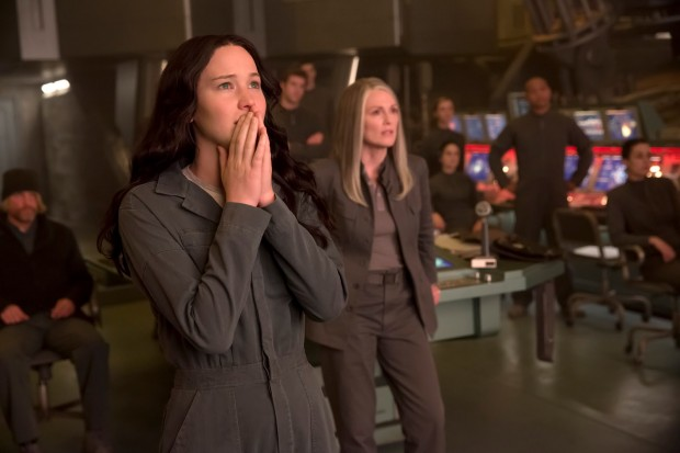 Katniss watches a broadcast from District 13 Command.