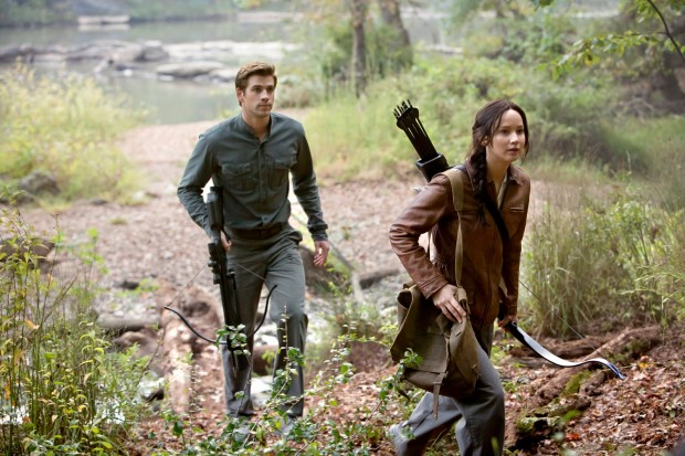 Katniss and Gale go hunting in the woods above District 13.