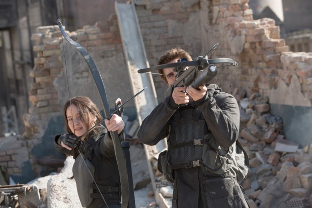 Katniss and Gale aim at Capitol bombers.