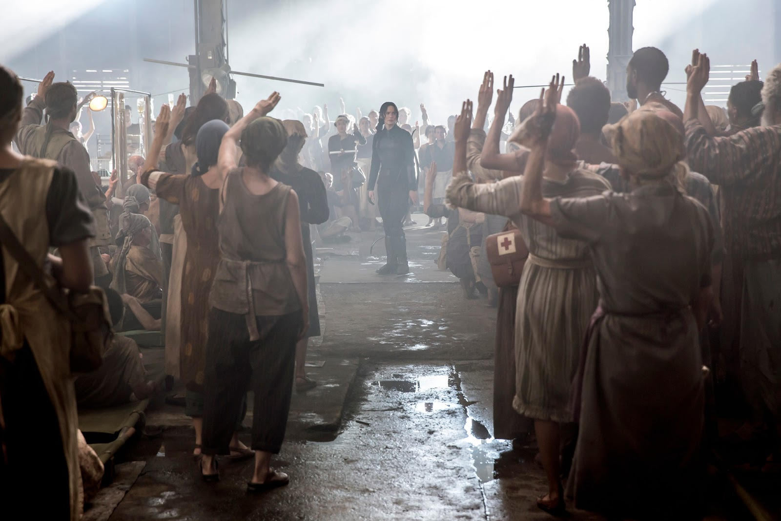Review mockingjay part 1 one reluctant voice ignites a the citizens of district 8 salute katniss buycottarizona