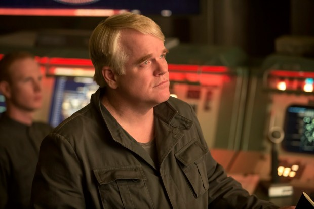 Plutarch watches a broadcast.
